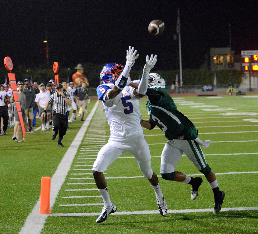 . Serra\'s Jordan Lasley hauls in a touchdown pass over Oceanside\'s Jace Whittaker in the 2013 Armed Forces Honor Bowl high school football game at Oceanside High School in Oceanside, CA. on Friday, September, 6 2013. (Photo by Sean Hiller/ Daily Breeze)