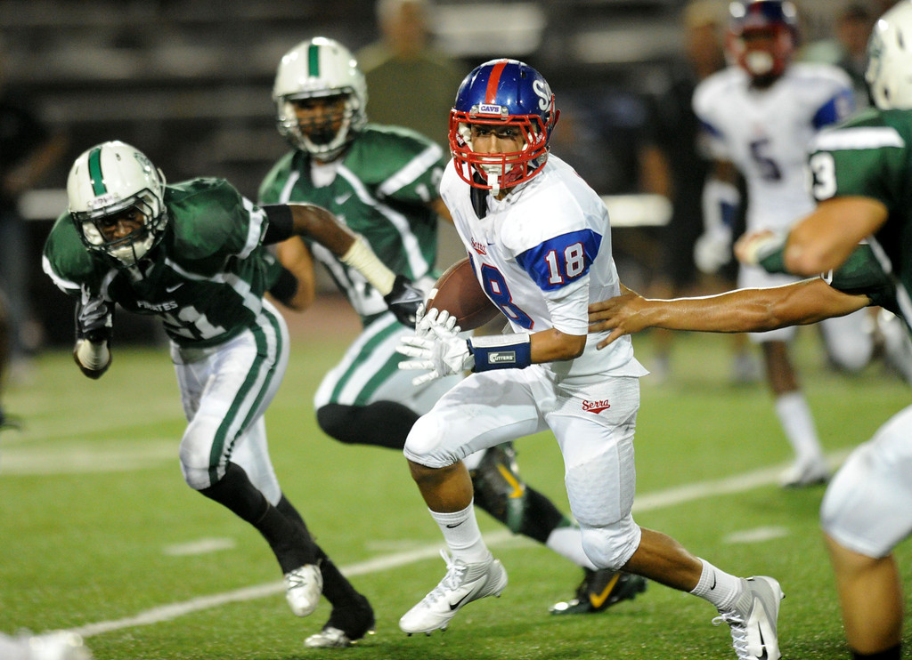 . The Serra Cavaliers\' Isaac Cox on a carry second quarter against  Oceanside Pirates in the 2013 Honor Bowl high school football game at Oceanside High School in Oceanside, CA. on Friday, September, 6 2013. (Photo by Sean Hiller/ Daily Breeze)