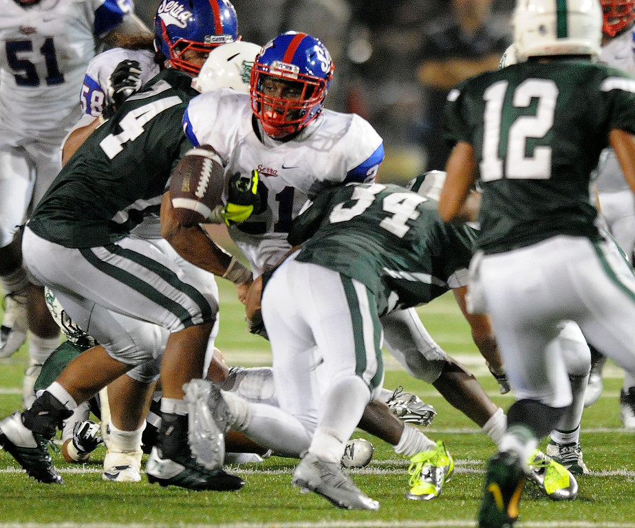 . The Serra Cavaliers\' Adoree\' Jackson fumbles the ball in the fourth quarter against the Oceanside Pirates in the 2013 Honor Bowl high school football game at Oceanside High School in Oceanside, CA. on Friday, September, 6 2013. (Photo by Sean Hiller/ Daily Breeze)