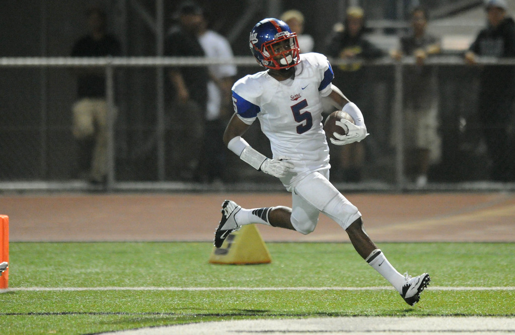 . Serra\'s Jordan Lasley runs in a touchdown to put Serra up over the Oceanside Pirates in the fourth quarter of the 2013 Honor Bowl high school football game at Oceanside High School in Oceanside, CA. on Friday, September, 6 2013. (Photo by Sean Hiller/ Daily Breeze)