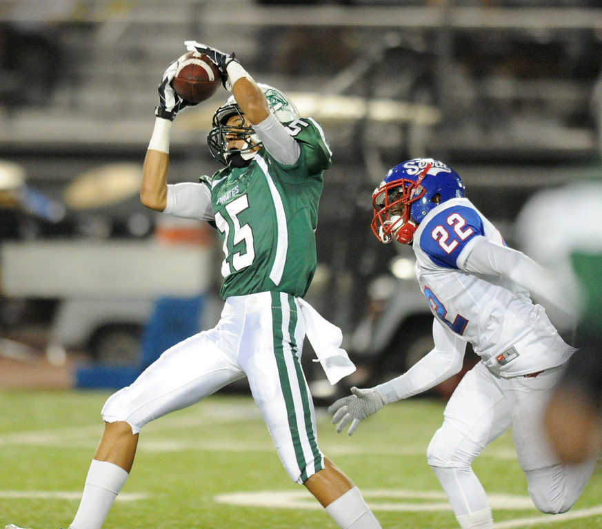 . The Serra Cavaliers vs. Oceanside Pirates in the 2013 Honor Bowl high school football game at Oceanside High School in Oceanside, CA. on Friday, September, 6 2013. Oceanside\'s Mikah Holder reels in a pass over Serra\'s Mikah Holder first half. (Photo by Sean Hiller/ Daily Breeze)