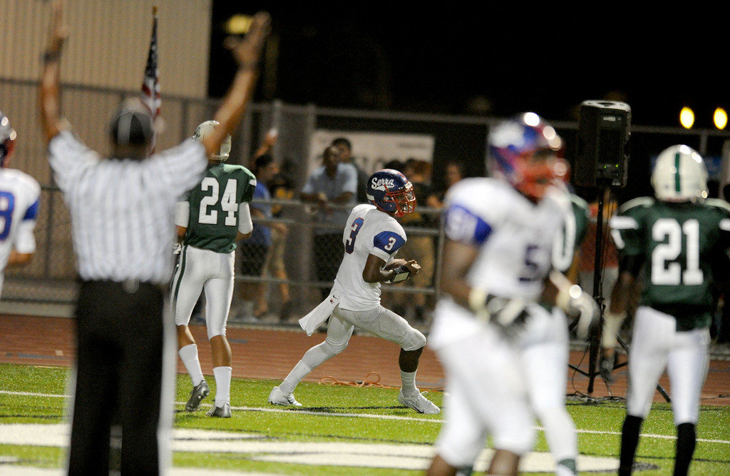. Serra Cavaliers\' quarterback Jalen Greene gets a touchdown against Oceanside Pirates second quarter in the 2013 Honor Bowl high school football game at Oceanside High School in Oceanside, CA. on Friday, September, 6 2013. (Photo by Sean Hiller/ Daily Breeze)