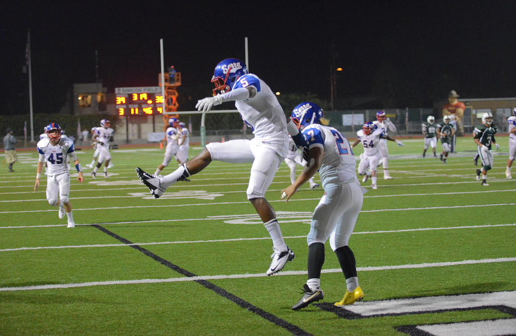 . Serra\'s Jordan Lasley celebrates his touchdown to put Serra up over the Oceanside Pirates with Sifa Maama (27) in the fourth quarter of the 2013 Honor Bowl high school football game at Oceanside High School in Oceanside, CA. on Friday, September, 6 2013. (Photo by Sean Hiller/ Daily Breeze)