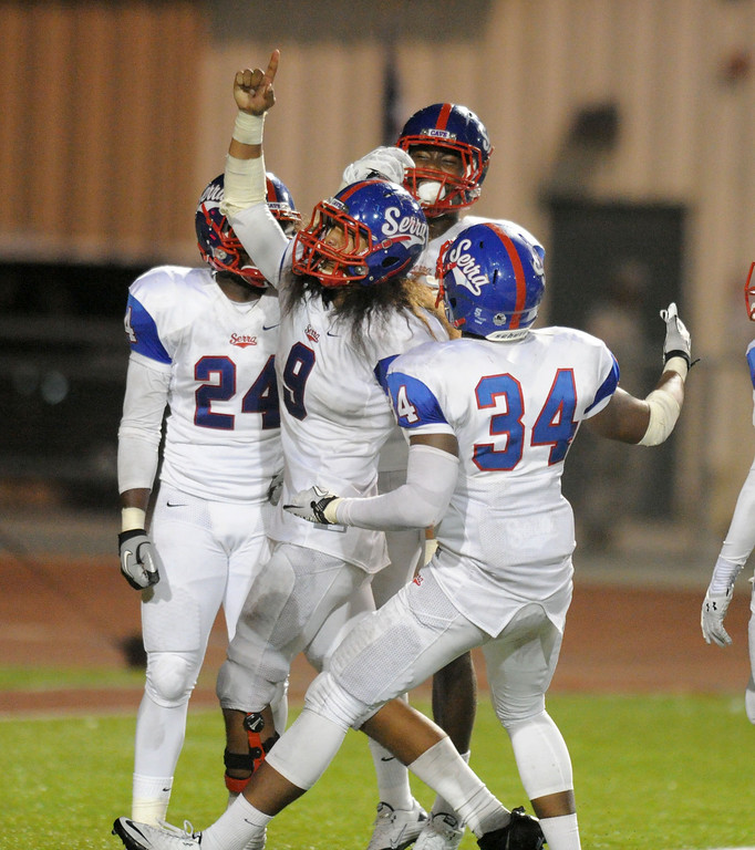 . Serra Cavaliers\' Malachi Mageo(9) celebrates after his touchdown on an interception late in the third quarter against the Oceanside Pirates in the 2013 Honor Bowl high school football game at Oceanside High School in Oceanside, CA. on Friday, September, 6 2013. (Photo by Sean Hiller/ Daily Breeze)