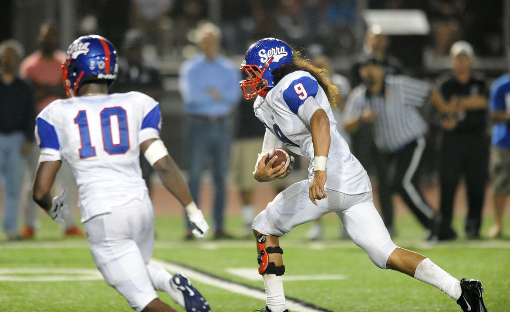. Serra Cavaliers\' Malachi Mageo runs with an interception to score late in the third quarter against the Oceanside Pirates in the 2013 Honor Bowl high school football game at Oceanside High School in Oceanside, CA. on Friday, September, 6 2013. (Photo by Sean Hiller/ Daily Breeze)
