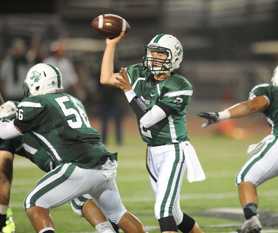 . The Serra Cavaliers vs. Oceanside Pirates in the 2013 Honor Bowl high school football game at Oceanside High School in Oceanside, CA. on Friday, September, 6 2013. Pirates\' quarterback Matthew Romero looks to pass. (Photo by Sean Hiller/ Daily Breeze)