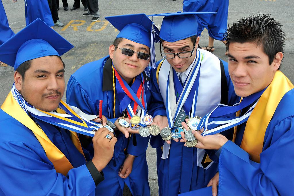 . LONG BEACH- 6/12/2013 - (Mark Savage) Victor Barragan, Caleb Murillo, Luis Morales, and Guillermo Trujillo attend Jordan High School commencement at Veterans Memorial Stadium.