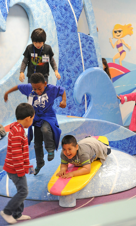 """. At LAX, a new play space for kids age 2-8 opened inside the new Tom Bradley International Terminal. \""""LAX Beach\""""  is the title and theme for the play area. (Dec 19, 2013. Photo by Brad Graverson/The Daily Breeze)"""