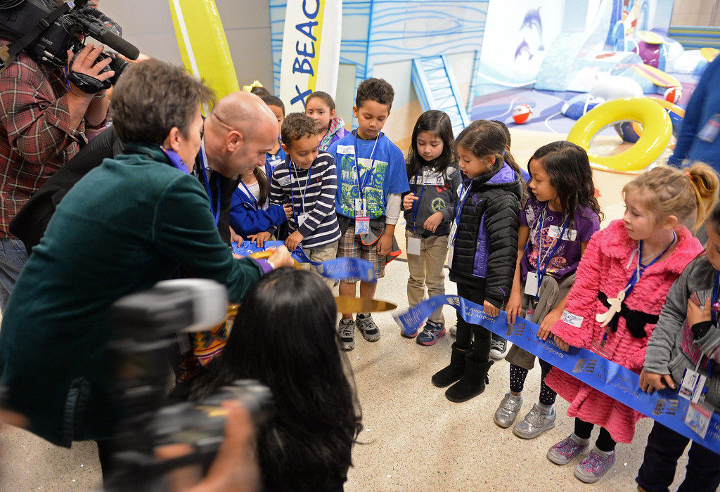 . At LAX, a new play space for kids age 2-8 opened inside the new Tom Bradley International Terminal. Grand opening ribbon is cut.   (Dec 19, 2013. Photo by Brad Graverson/The Daily Breeze)
