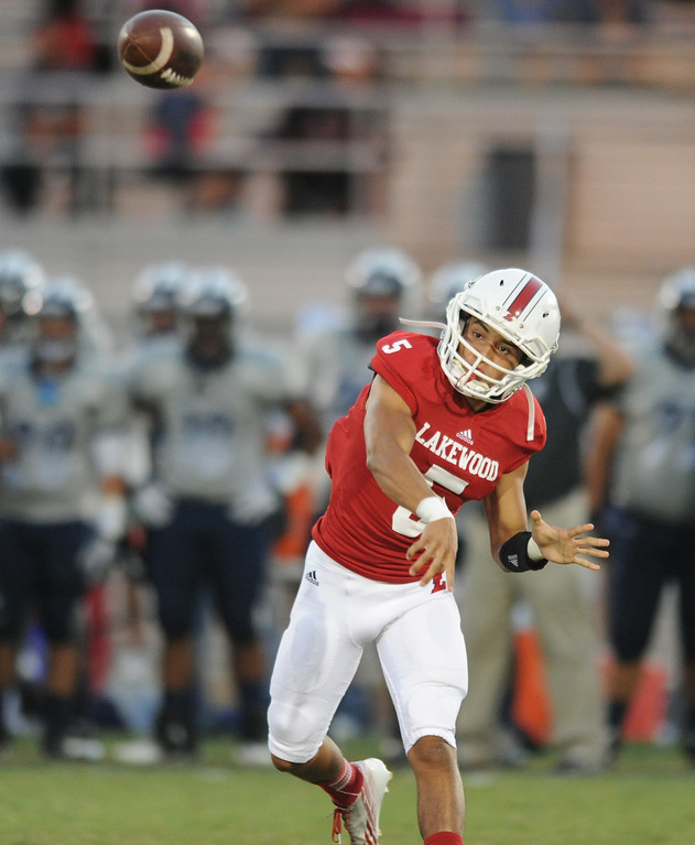. Lakewood\'s quarterback Kyle Parra fires off a pass against Mayfair as they play at Bellflower High School for the Milk Bucket Trophy in Bellflower, CA. on September 13, 2013. (Photo by Sean Hiller/Press Telegram)