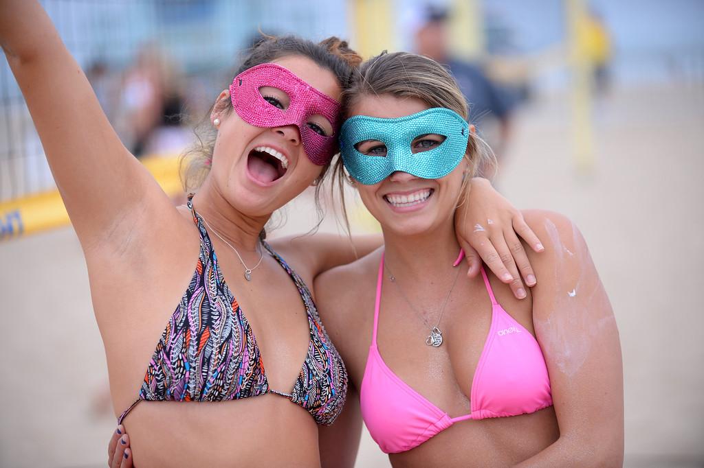 . Team Sparkle teammates Monica Stauber and Candace Nicholson. Manhattan Beach Charlie Saikley 6-man beach volleyball tournament.   Photo by Brad Graverson 7-31-13
