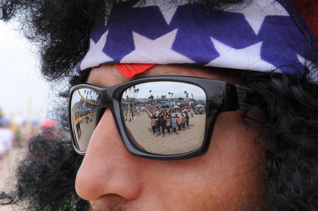 . Team Fletch  eyes the competition. Manhattan Beach Charlie Saikley 6-man beach volleyball tournament.   Photo by Brad Graverson 7-31-13