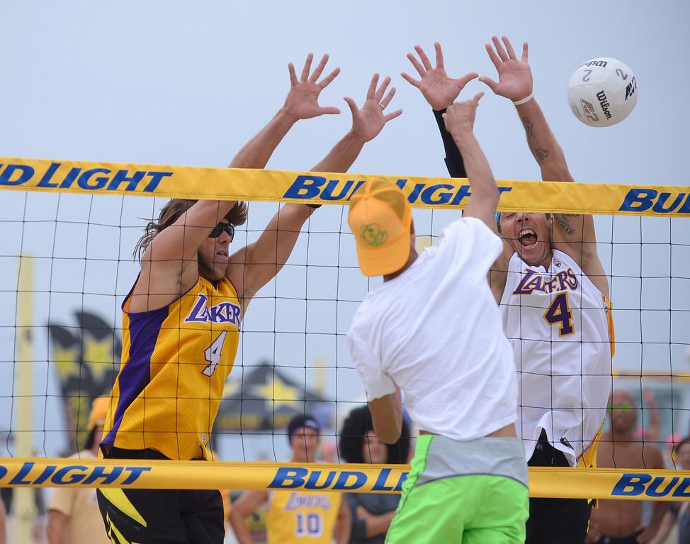 . Team Fletch on defense. Manhattan Beach Charlie Saikley 6-man beach volleyball tournament.   Photo by Brad Graverson 7-31-13