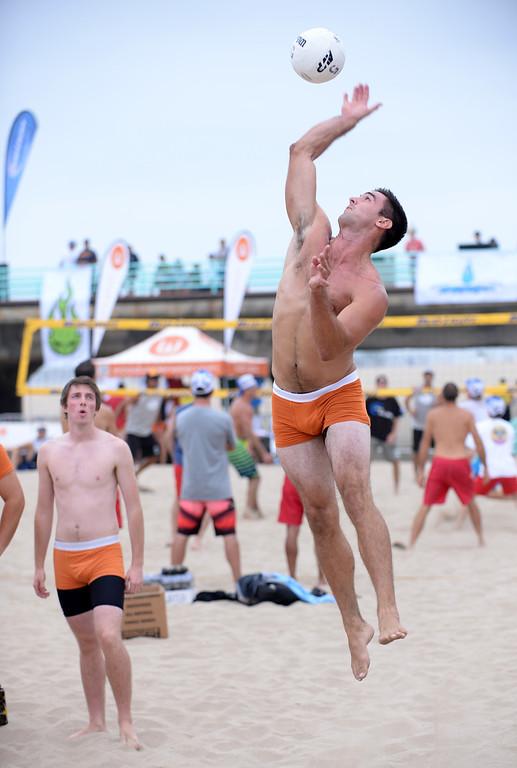 . Team Wood. Manhattan Beach Charlie Saikley 6-man beach volleyball tournament.   Photo by Brad Graverson 7-31-13