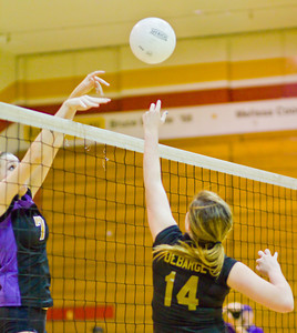 Apaches' Ashleigh Debarge taps the ball over the net as the Brahmas' Kate Corbett defends during a first round CIF Playoff volleyball match between the Arcadia High School Apaches and the visiting Diamond Bar Brahmas in Arcadia, CA on November 10, 2009.  (STAR/TRIB/Correspondent photo by David Thomas/SPORTS)