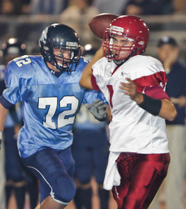 Apaches' Garrett Tuck (7) throws the ball under pressure from the Falcons' Bryan Luna (72) during a football game between the Crescenta Valley High School Falcons and the visiting Arcadia High School Apaches in Glendale, CA on November 12, 2009.  (STAR-NEWS/Correspondent photo by David Thomas/SPORTS)