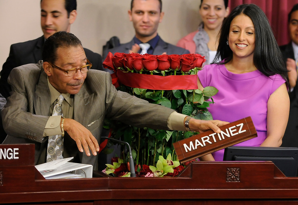 . Los Angeles City Council President Herb Wesson puts Nury Martinez name plate in front of her seat moments after she is sworn into office for District 6. The council met in Van Nuys City Hall. Van Nuys , CA. 8/2/2013(John McCoy/LA Daily News)
