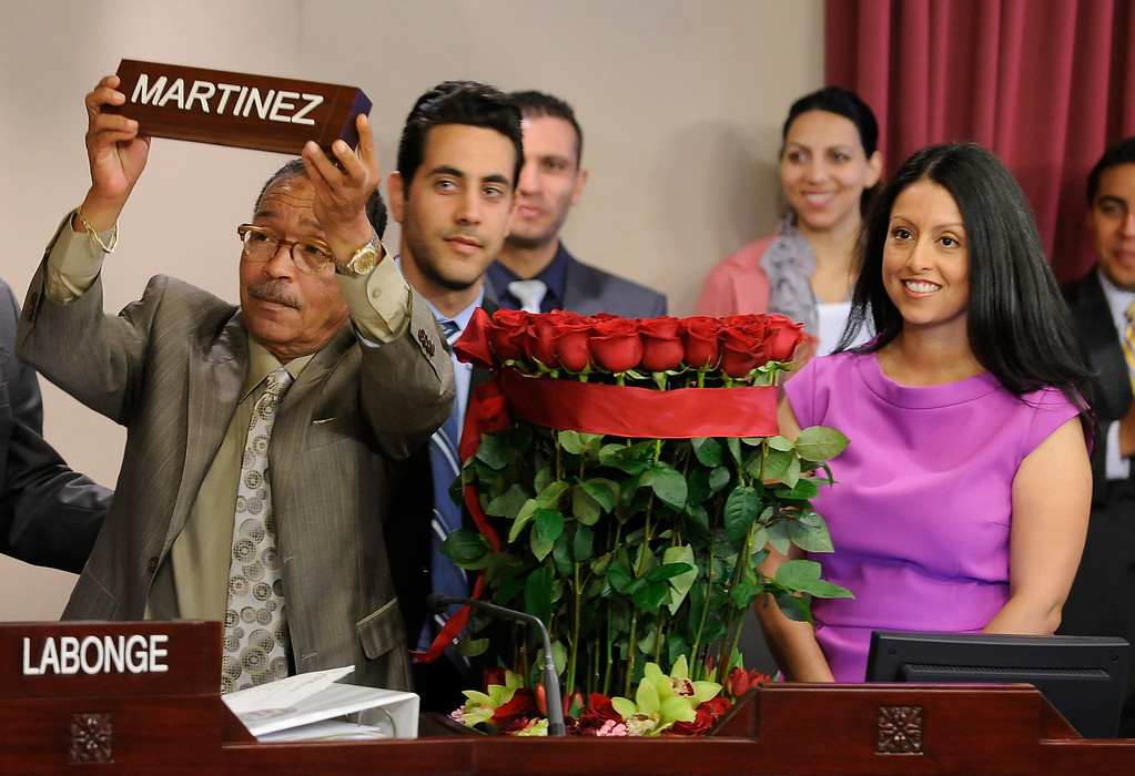 . Herb Wesson holds up the name plate for Nury Martinez, who is the newest Los Angeles City Council member, representing District 6. The council met in Van Nuys City Hall. Van Nuys , CA. 8/2/2013(John McCoy/LA Daily News)
