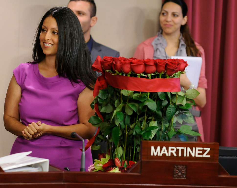 . Nury Martinez stands with the large bouquet of roses that was given to her by the City Council. Martinez is the newest Los Angeles City Council member, representing District 6. The council met in Van Nuys City Hall. Van Nuys , CA. 8/2/2013(John McCoy/LA Daily News)