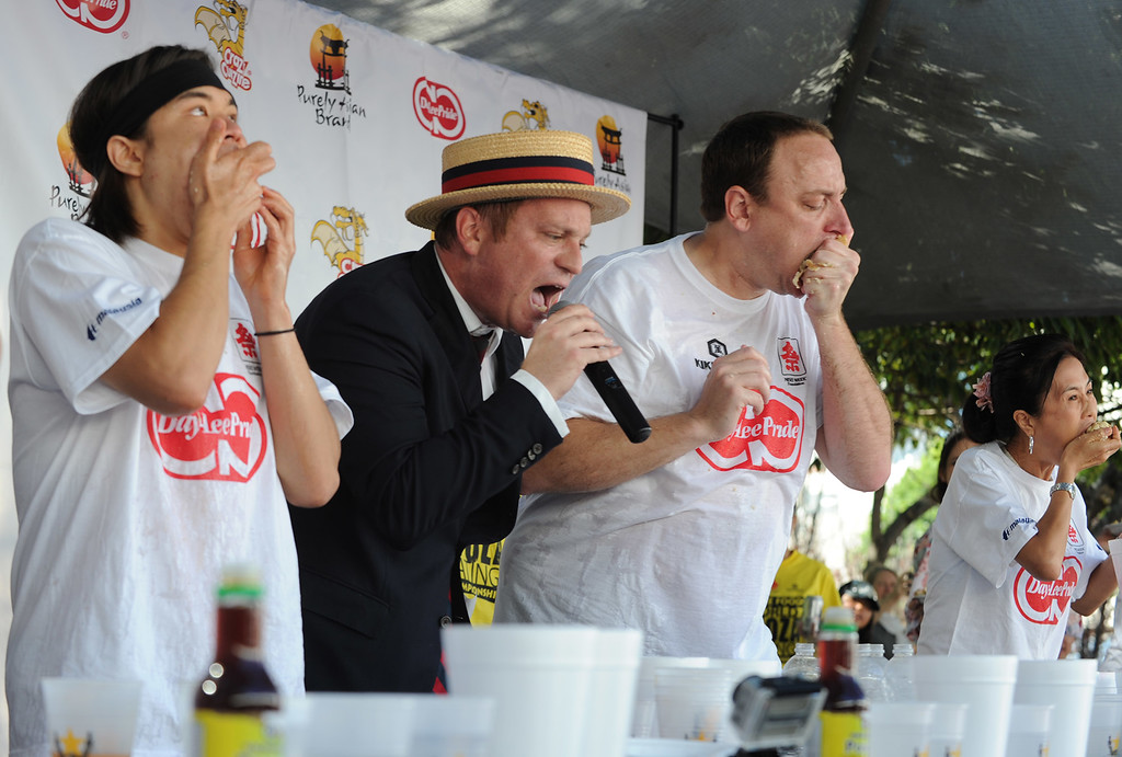 . Sam Barclay, the MC, counts down the final seconds. The World Gyoza Eating Contest took place as part of the annual Nisei Week Foundation festival. Matt Stonie of San Jose ended up setting a new world record by eating 268 pot stickers, edging out last years winner Joey Chestnut who ate 251. Los Angeles, CA. 8/17/2013(John McCoy/LA Daily News)