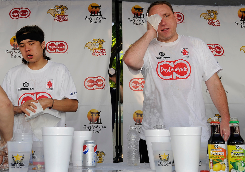 . At the end of the competition Matt Stonie and Joey Chestnut look stuffed. The World Gyoza Eating Contest took place as part of the annual Nisei Week Foundation festival. Matt Stonie of San Jose ended up setting a new world record by eating 268 pot stickers, edging out last years winner Joey Chestnut who ate 251. Los Angeles, CA. 8/17/2013(John McCoy/LA Daily News)