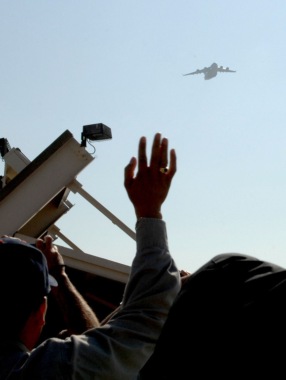 . 9/12/13 - Boeing employees waved to the aircraft as the company delivered the last U.S. Air Force C-17 Globemaster III, fulfilling the production contract, on Thursday morning. (Photo by Brittany Murray/Press Telegram)
