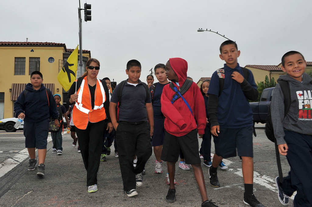 ". 9/11/12 - Students from Roosevelt Elementary school have had to walk an extra mile as their campus undergoes construction in the ""Walking School Bus.\""  Some parents say the walk is too much, children complain of sore legs and being tired before their school day begins. Each day approximately 60 students meet at E. 16th St. and Long Beach Boulevard and walk to the now defunct Butler school campus (where Roosevelt has relocated until construction wraps). Butler is at 1400 E 20th St, Long Beach, CA 90806. It is 1.2 miles away from Roosevelt and takes about 40 minutes. Most parents are walking their children from long distances, some from Magnolia Avenue. Some who must work are sending their children alone. (Photo by Brittany Murra/Press Telegram)"