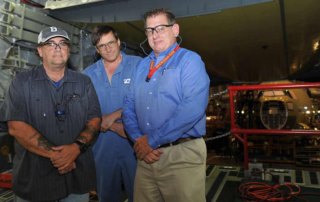 . 8/29/13 - L-R Richard Pepin, aircraft structure mechanic, Willie White, aircraft hidrolyc mechanic and Michael Sanderson, senior manager frontline operations, together have 82 years of Boeing service. Boeing prepares to deliver the last domestic C-17 on Sept. 12 to Charleston, S.C., home of the first C-17.  Photo by Brittany Murray, Press Telegram