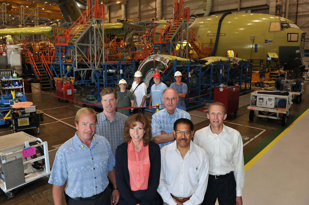 . 8/29/13 - L-R front group of people, Dan Anderson, production manager, Don Snow, technical fellow, Nancy Wrobleski, manager propulsion engineering, Bob Person, associate technical fellow, Dennis Durant, propulsion engineer and David Gillingham propulsion engineer with assembly mechanics in the background in front of a C17 in production. Photo by Brittany Murray / Press Telegram