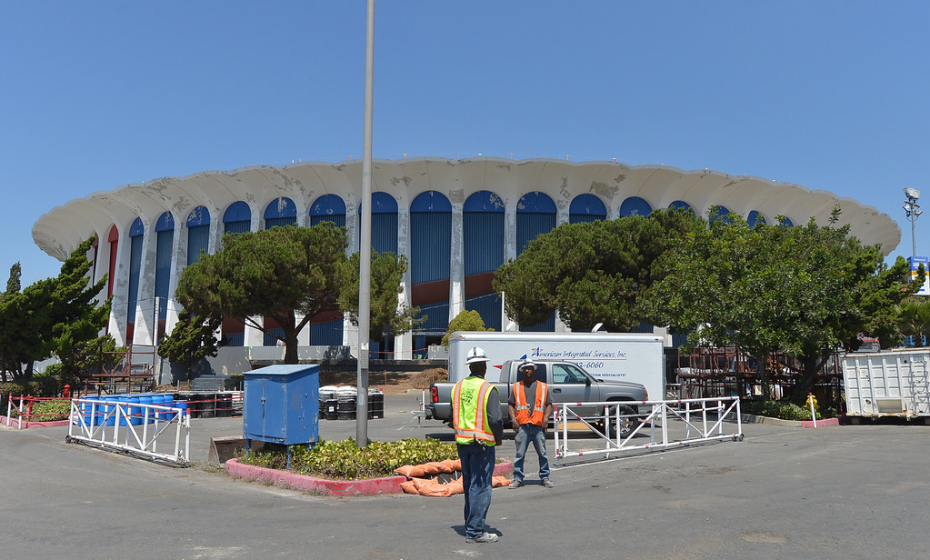 . 0731_NWS_TDB-L-FORUM-- 20130730 - Inglewood, CA --Daily Breeze Staff Photo: Robert Casillas / LANG --- The Madison Square Garden Company which acquired the Forum in Inglewood in June of 2012 announced its plans to invest $100 million to restore the iconic venue. On hand for the event were members of The Eagles who will reopen the venue with concert in January of 2014. Workers have already removed top section of building.
