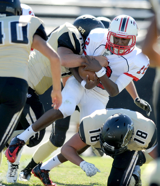 . Peninsula\'s Luke Megginson (78) ,left, tackles Lawndale\'s quarterback Chris Murray in Friday afternoon\'s high school football game in Rolling Hills Estates in CA. on September 27, 2013. (Photo by Sean Hiller/Daily Breeze)
