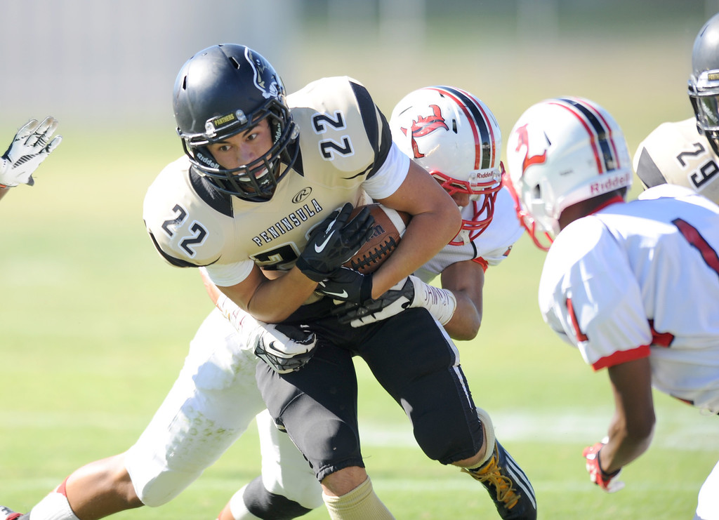 . Peninsula\'s Rory Hubbard (22) on a carry against  Lawndale in Friday afternoon\'s high school football game in Rolling Hills Estates in CA. on September 27, 2013. (Photo by Sean Hiller/Daily Breeze)