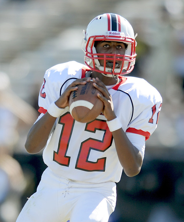 . Lawndale\'s quarterback Chris Murray looks to pass in Friday afternoon\'s high school football game in Rolling Hills Estates in CA. on September 27, 2013. (Photo by Sean Hiller/Daily Breeze)