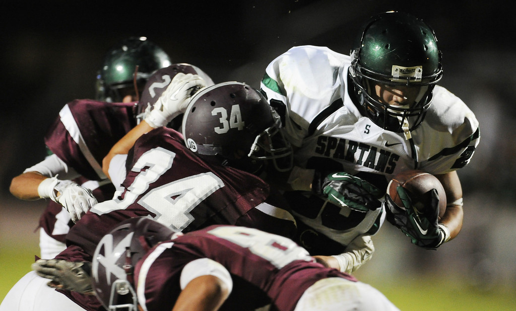 . South Torrance\'s Brandon Chavez runs for a touchdown past Rosemead\'s Jasper Chavez (C) (34) in the first half of a prep football game at Rosemead High School in Rosemead, Calif. on Thursday, Sept. 12, 2013.   (Photo by Keith Birmingham/Pasadena Star-News)