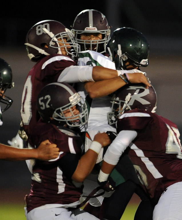 . Rosemead\'s Michael Sahagun (80) along with Demarco Munoz (52) tackles South Torrance\'s Anthony Peters (3) for a loss of yards in the first half of a prep football game at Rosemead High School in Rosemead, Calif. on Thursday, Sept. 12, 2013.   (Photo by Keith Birmingham/Pasadena Star-News)