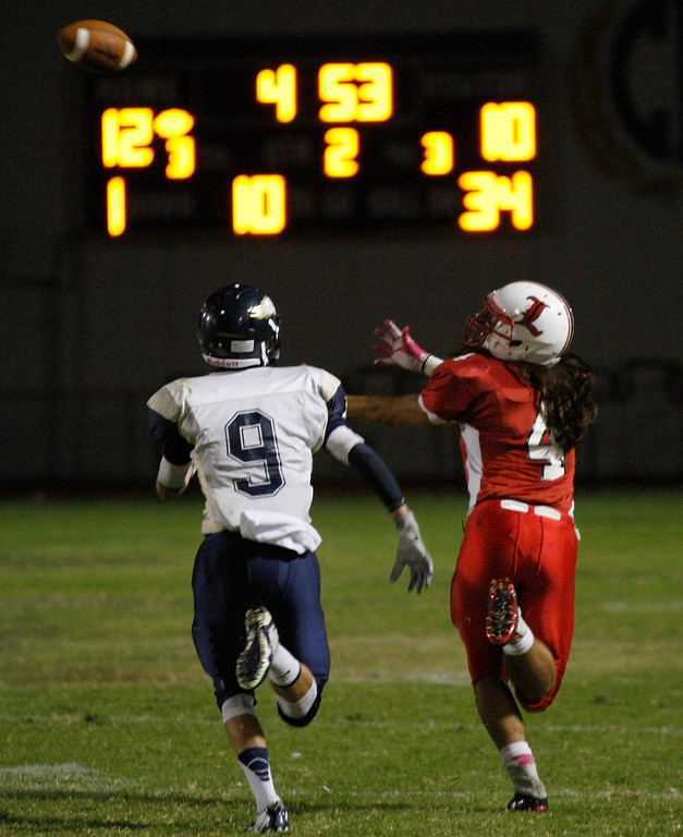 . Wide receiver Richard Rivera #4 of Lawndale stretches for the ball in front of the defense of El Segundo during a Pioneer League matchup at Leuzinger High School on Friday, October 11, 2013 in Lawndale, Calif.  (Michael Yanow / For the Daily Breeze)