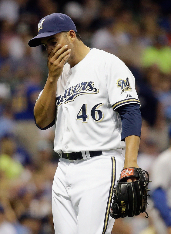 . Milwaukee Brewers starting pitcher Hiram Burgos reacts after being taken out of the game during the fourth inning of a baseball game against the Los Angeles Dodgers Tuesday, May 21, 2013, in Milwaukee. (AP Photo/Morry Gash)