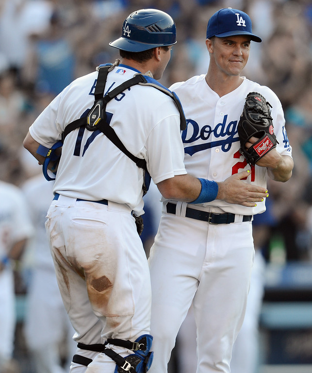 . The Dodgers\' Zack Greinke #21 gets congratulated by catcher A.J. Ellis #17 after winning their game against the Rockies at Dodger Stadium in Los Angeles Saturday, July 13, 2013. The Dodgers beat the Rockies 1-0.(Hans Gutknecht/Los Angeles Daily News)