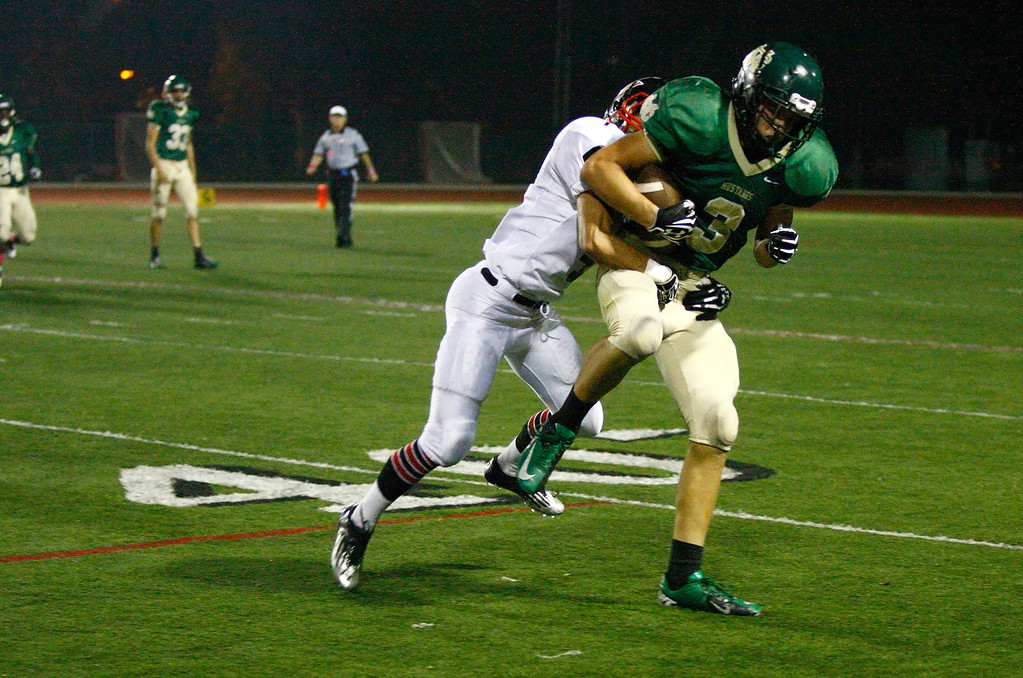 . Wide receiver Harrison Morrow #3 of Mira Costa is tackled by the Palos Verdes defense during a Bay League matchup at Mira Costa High School on Friday, October 18, 2013 in Manhattan Beach, Calif.  (Michael Yanow / For the Daily Breeze)