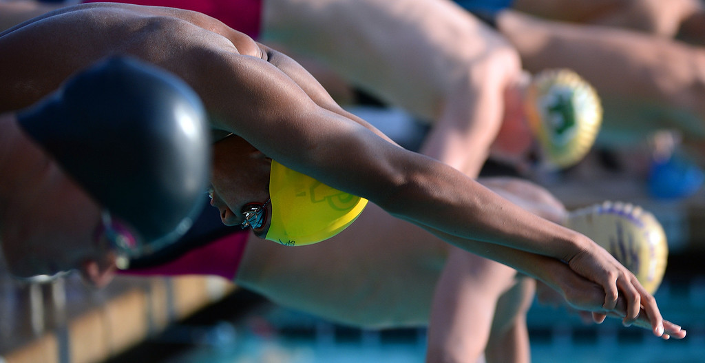 . Notre Dame\'s (Riverside) Roman Sarmiento starts the 100 yard freestyle during the Division 4 CIF Southern Section Swimming Championships in the Riverside Aquatics Complex at Riverside City College in Riverside, Calif., on Friday, May 16, 2014.  (Keith Birmingham/Pasadena Star-News)