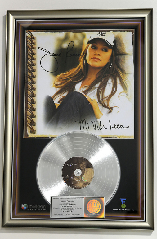 . Dec. 9 marks the one year anniversary of the death of singer Jenni Rivera. Jenni Rivera memorabilia adorn the walls inside the Jenni Rivera Boutique in Panorama City,  for the release of her new live album, which was recorder just before her death after her plane crashed in Mexico.  Panorama City Calif., December 3, 2013.   (Photo by Stephen Carr / Daily Breeze)