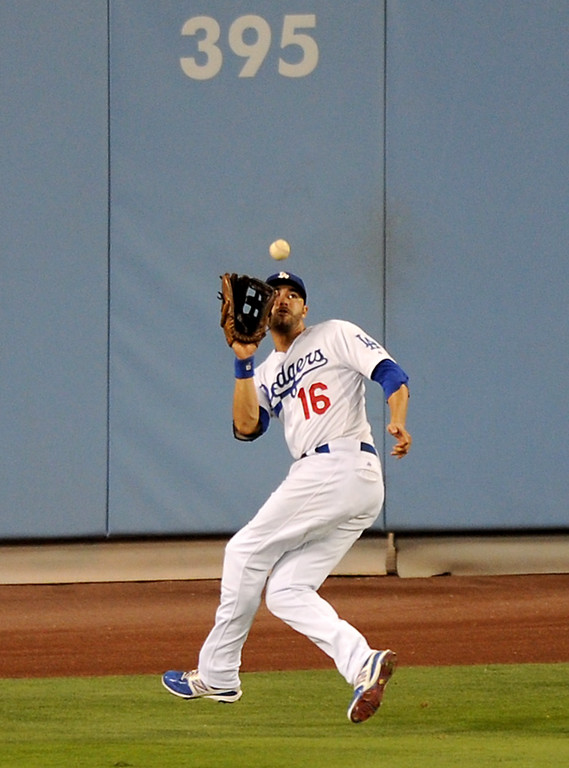 . Dodgers center fielder Andre Ethier makes a running catch on a flyball by the Red Sox\' David Ortiz, Friday, August 23, 2013. (Michael Owen Baker/L.A. Daily News)
