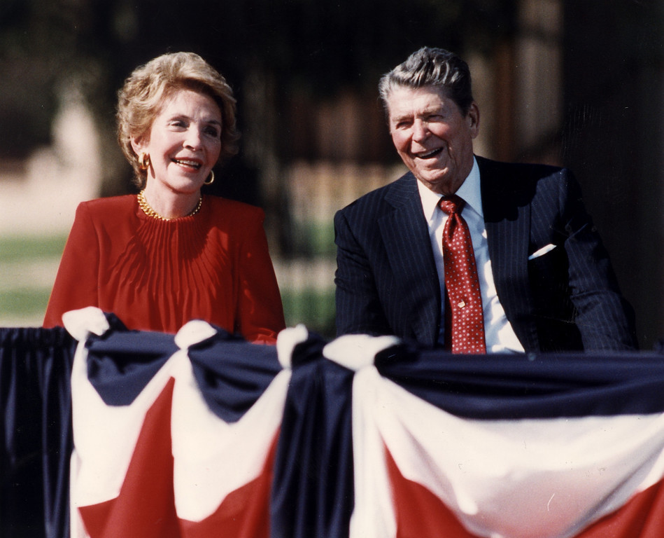 . 11/04/91-Simi Valley--Former first lady Nancy Reagan, and former president Ronald Reagan laugh at a joke during the Ronald Reagan Presidential Library opening ceremony.  (Los Angeles Daily News file photo)