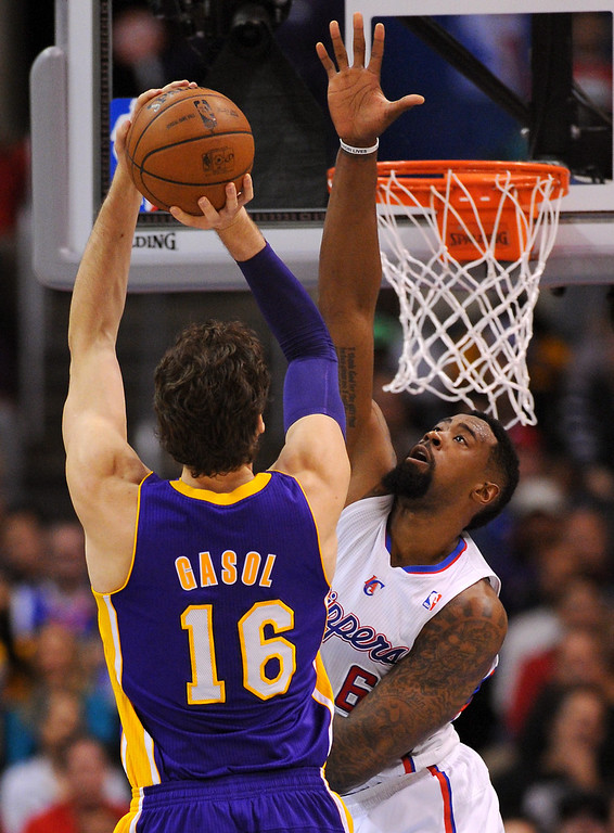 . Clippers DeAndre Jordan defends the hoop as Lakers\' Pau Gasol shoots in the first half, Friday, January 10, 2014, at Staples Center. (Photo by Michael Owen Baker/L.A. Daily News)