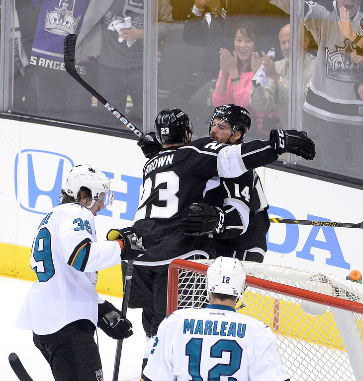 . Los Angeles Kings right wing Justin Williams (14) is hugged by teammate right wing Dustin Brown (23) after scoring against the San Jose Sharks during the second period in Game 4 of an NHL hockey first-round playoff series at Staples Center in Los Angeles on Thursday, April, 24  2014.  (Keith Birmingham Pasadena Star-News)