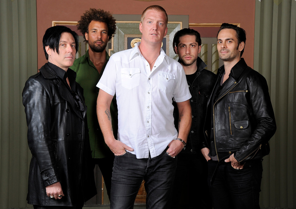 . August 17, 2013: Queens of the Stone Age<br /> <br />In this May 23, 2013 photo, members of the band Queens of the Stone Age, from left, Troy Van Leeuwen, Jon Theodore, Josh Homme, Michael Shuman and Dean Fertita pose for a portrait at the Wiltern Theater, in Los Angeles.     (Photo by Chris Pizzello/Invision/AP)