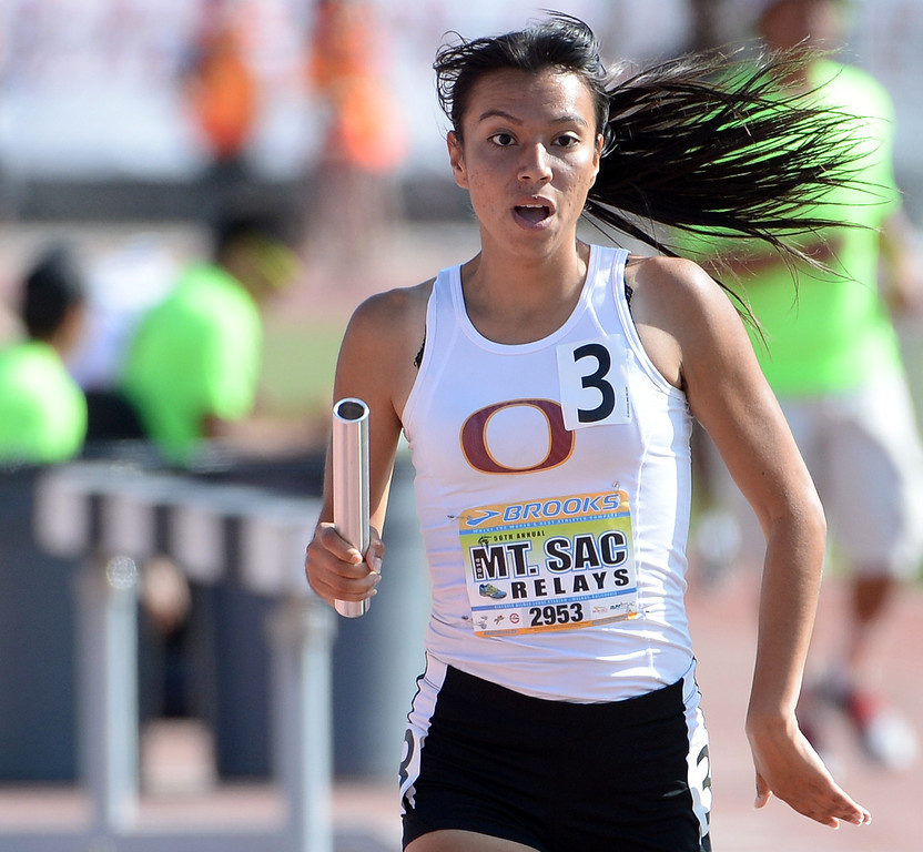 . Ontario\'s Beatriz Lopez runs the final leg of the 1600 medley seeded during the Mt. SAC Relays in Hilmer Lodge Stadium on the campus of Mt. San Antonio College in Walnut, Calif., on Saturday, April 19, 2014. 