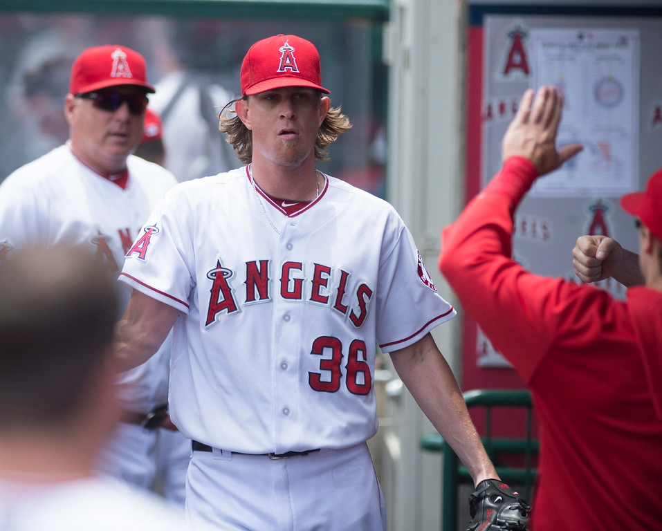 . Angels pitcher Jered Weaver (#36) is congratulated after striking out the side in the first inning against the Minnesota Twins at Angel Stadium in Anaheim on Thursday June 26, 2014. (Photo by Keith Durflinger/Whittier Daily News)