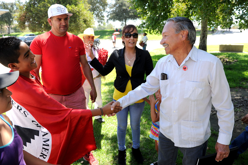 ". UFW President Arturo Rodriguez, right, greets people before at the ""Caravan for Citizenship\"" rally at Yokuts Park in Bakersfield, Wednesday, August 14, 2013. (Michael Owen Baker/L.A. Daily News)"