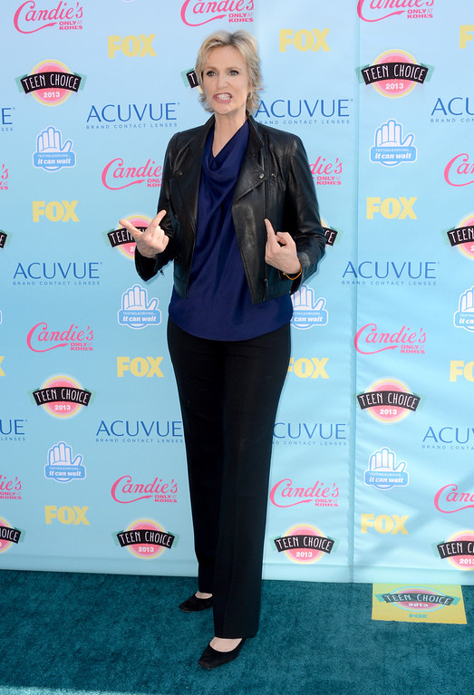 . Jane Lynch arrives at the Teen Choice Awards at the Gibson Amphitheater on Sunday, Aug. 11, 2013, in Los Angeles. (Photo by Jordan Strauss/Invision/AP)